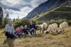 Blacknose Sheep farmer and his family in front of the Matterhorn in Zermatt