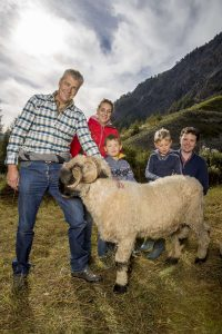 Blacknose Sheep farmer and family in front of the Matterhorn in Zermatt
