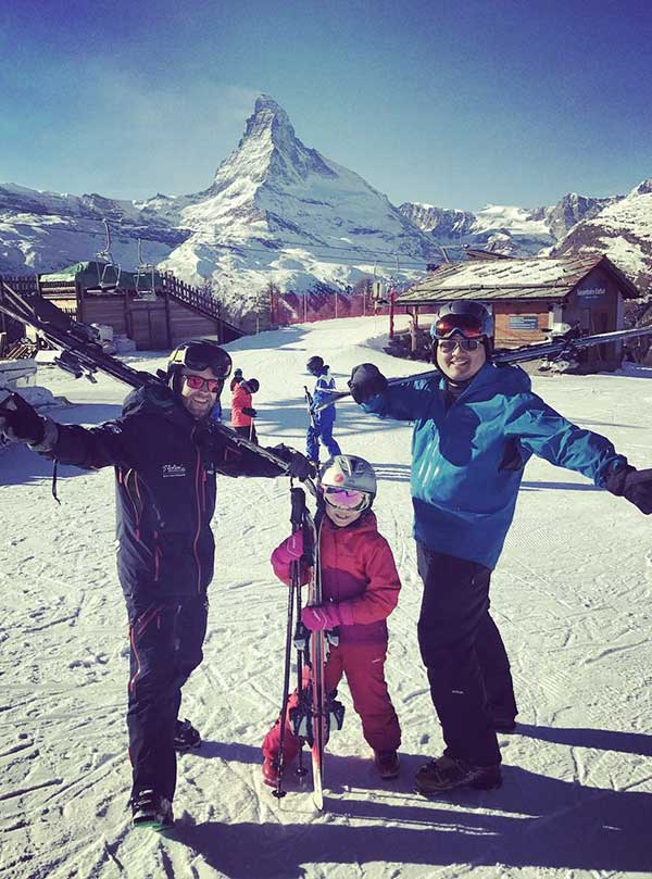 Chinese skiers in front of the Matterhorn