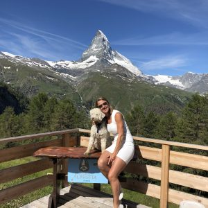 Tanja together with her dog, Marley on the terrace and in the background the Matterhorn