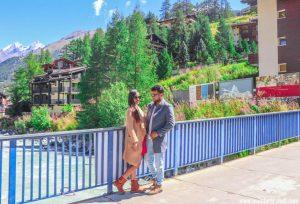 a man and a woman on a bridge in Zermatt